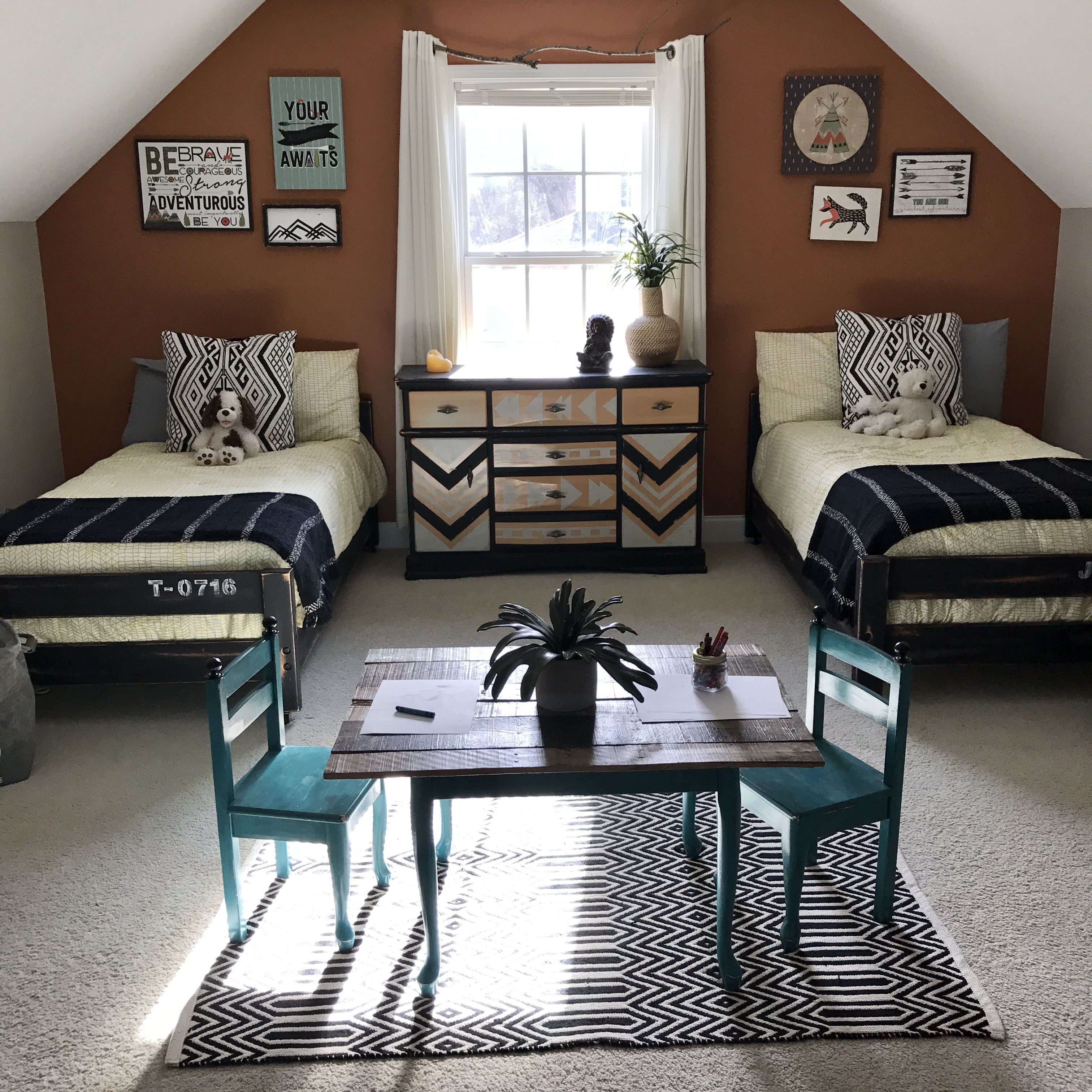 boho bedroom for boys with aztec prints, black and white decor